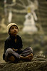 Young boy with Stupa in background, at Maratika, Nepal, by Mannie Garcia