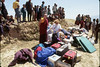 Sorting luggage at Maratika, Nepal, as villagers look on, by Mannie Garcia