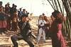 Mannie Garcia photographing Jetsunma Ahkon Lhamo at Maratika, Nepal, as villagers look on, by Wib Middleton