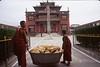 Monks bring bread for Shechen Monastery, Kathmandu, Nepal, by Mannie Garcia