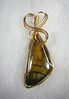 "Golden tigereye, all wrapped up in gold-filled wire, 2-316"" long.<br /> (op3776z)"