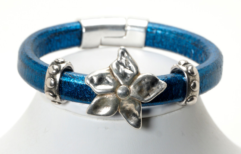 #24615B<br>Pewter flower<br>On metallic blue leather.<br> Magnetic clasp.<br> Available in small, small/medium and medium.<br>$95.00