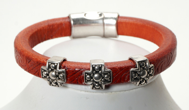 #11718B<br>Pewter crosses<br>On embossed red leather.<br> Magnetic clasp.<br> Available in small, small/medium and medium.<br>$95.00