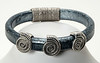#16216B<br>Pewter slides<br>On distressed pewter leather.<br> Magnetic clasp.<br> Available in small, small/medium and medium.<br>$95.00