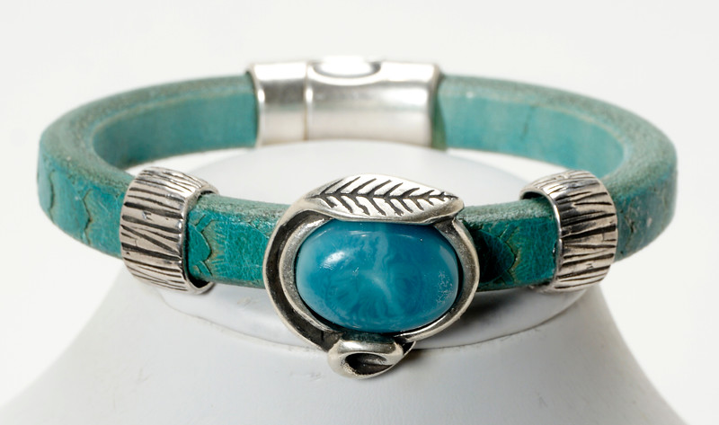 #22415B<br>Pewter and turquoise resin<br>On distressed turquoise leather.<br> Magnetic clasp.<br> Available in small, small/medium and medium.<br>$95.00