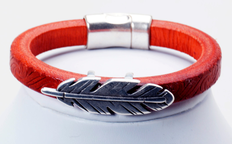 #17418B<br>Pewter feather<br>On embossed red leather.<br>Magnetic clasp.<br> Size small- other sizes available.<br>$95.00