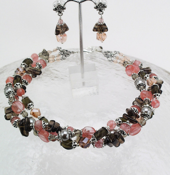"#11611 <br>Strawberry quartz, crystal, smokey quartz, glass pearl and pewter. <br>Silver plated clasp and 4"" extender chain. <br> Alice Bailey Designs signature tag.<br> Necklace 16"" to 20"" Limited Edition $175.00.<br>Earrings with pewter and surgical steel posts $36.00"