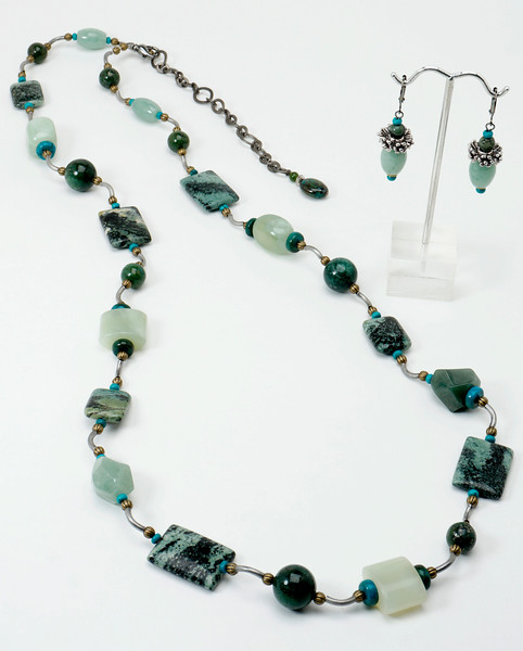 "#10217 <br>Zebra agate, jade, green aventurine, turquoise, crysocolla and pyrite. Antiqued bronze tubes, clasp and 4"" extender chain. <br>Necklace 36"" to 40"" Limited Edition $135.00<br>Earrings with antiqued bronze French clips $27.00"