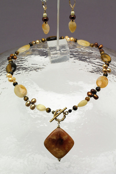 "<font><b> #05007 <br> Antique Jade drop on tiger eye, yellow jade, agate,<br> vermeil gold and pearls. <br>Gold fill toggle clasp.<br>Alice Bailey Designs signature tag.<br>Necklace18"" Limited Edition. $99.00<br> Earrings with gold fill French clips $46.00</b></font>"