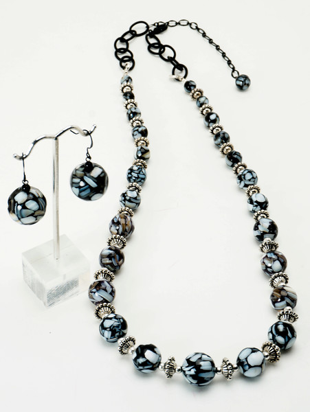 "#22519<br>Graduated black &amp; white shell mosaic beads and pewter.<br>Nite black clasp and 4"" extender chain.<br>27"" to 31"" Limited Edition.<br>Necklace $95.00<br>Earrings $28.00"
