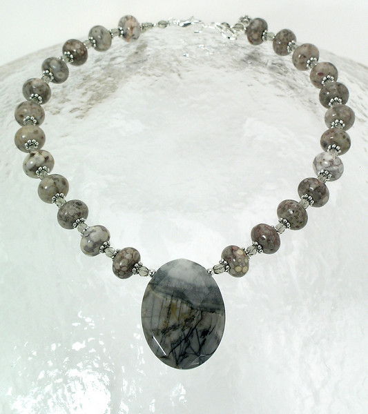 "#16211 <br>Faceted jasper oval on jasper, crystal and pewter. <br>Silver plated clasp and 4"" extender chain.<br> Alice Bailey Designs signature tag.<br> 17"" to 21"" Limited Edition $75.00"