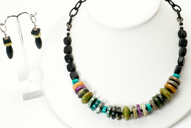 """#11719<br>Multi-stone Heishi<br>And matte onyx. <br> Nite black chain, clasp and 4"""" extender chain.<br>17"""" to 21"""" Limited Edition.<br>Necklace $95.00<br>Earrings $28.00"""