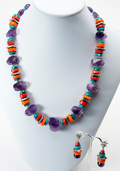 """#15217 Faceted amethyst, coral &amp; turquoise heishi and pewter.<br>Silver plated clasp and 4"""" extender chain. <br>Alice Bailey Design signature tag.<br> 18"""" to 22"""" Limited Edition.<br><br><a href=""""https://www.paypal.com/cgi-bin/webscr?cmd=_cart&amp;add=1&amp;business=alice@AliceBaileyDesigns.com&amp;item_name=Alice%20Bailey%20Designs%20Item%20Number%2015217%20Necklace&amp;item_number=15217&amp;amount=%24125.00&amp;return=http://www.paypal.com&amp;cancel_return=http://www.paypal.com"""" target=""""_click"""" class=""""paypalbutton"""">Purchase Necklace $125.00</a><br><br> <br><br><a href=""""https://www.paypal.com/cgi-bin/webscr?cmd=_cart&amp;add=1&amp;business=alice@AliceBaileyDesigns.com&amp;item_name=Alice%20Bailey%20Designs%20Item%20Number%2015217%20Earrings&amp;item_number=15217&amp;amount=%2429.00&amp;return=http://www.paypal.com&amp;cancel_return=http://www.paypal.com"""" target=""""_click"""" class=""""paypalbutton"""">Purchase Earrings $29.00</a><br><br> <br><br><a href=""""https://www.paypal.com/cgi-bin/webscr?cmd=_cart&amp;add=1&amp;business=alice@AliceBaileyDesigns.com&amp;item_name=Alice%20Bailey%20Designs%20Item%20Number%2015217%20Earrings%20and%20Necklace&amp;item_number=15217&amp;amount=%24154.00&amp;return=http://www.paypal.com&amp;cancel_return=http://www.paypal.com"""" target=""""_click"""" class=""""paypalbutton"""">Purchase Necklace and  Earrings $154.00</a><br><br> <br><br><br><br><img src=""""http://ali.smugmug.com/Other/WebSiteImages/i-BftLFq2/0/O/paypal-175-50-O.jpg""""><br><font class=""""captionfooter"""">Free Shipment on all Orders</font>"""