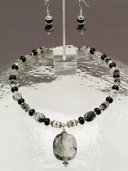 "#13410 <br>Tourmaline quartz, black onyx, <br>pewter and crystal. <br>Silver plated clasp and 4"" extender chain.<br>Alice Bailey Designs signature tag.<br>Necklace 16"" to 20"" Limited Edition $85.00<br>Earrings with sterling silver ear wires $27.00"