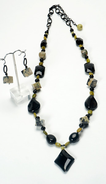 "#12720BN<br>Amazon turquoise, black onyx and agate.<br>Nite black chain, clasp<br>And 4"" extender chain.<br>31"" to 35"" One-of-a-kind.<br>Necklace $155.00<br>Earrings$28.00"