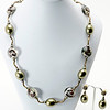 """#21919<br>Olive shell pearls, lamp glass <br>And antiqued bronze tubes.<br>Antiqued bronze clasp and 4"""" extender chain.<br>32"""" to 36"""" Limited Edition.<br>necklace $125.00<br>Earrings $29.00"""