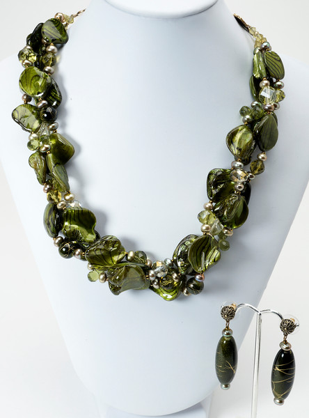 """#27116 <br>Triple strands of shell, pearl, crystal and acrylic. Antiqued bronze ABD connectors, clasp and 4"""" extender chain. <br> Necklace 18"""" to 22"""" Limited Edition $195.00<br>Earrings with antiqued bronze filigree ear posts $25.00"""