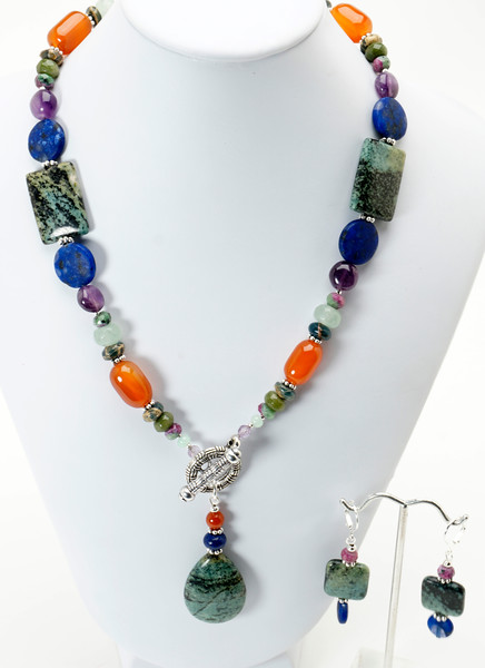 """#19319 <br>Green Zebra agate drop, carnelian, <br>Lapis, green aventurine, jade and amethyst. <br>Pewter toggle clap.<br>18"""" Limited Edition.<br>Necklace $95.00 Earrings $28.00"""