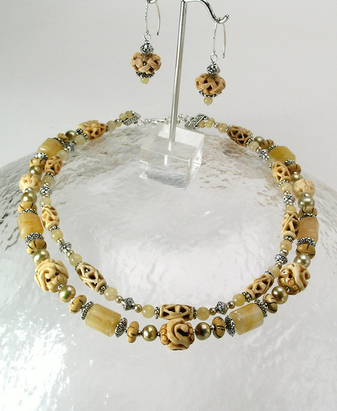 "#17214 <br>Carved bone, yellow jade, pearls, blond onyx and pewter. <br>Silver plated clasp and 4"" extender chain. <br>Alice Bailey Designs signature tag. <br>necklace 18"" to 22"" Limited Edition $175.00<br>Earrrings with silver fill ear wires $42.00"