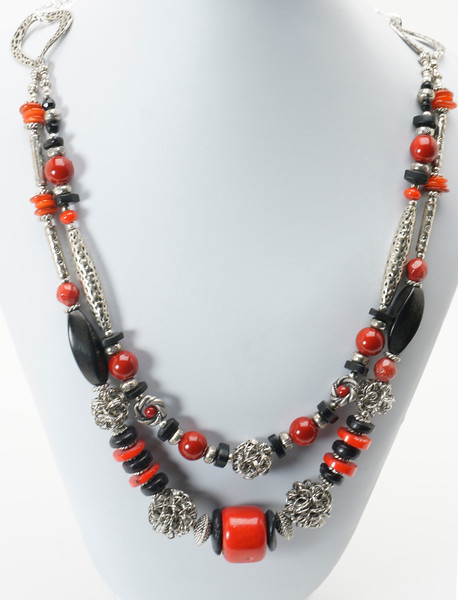 "#22319<br>Two strand necklace of red coral, <br>Black horn, wood, pewter and <br>Steel wire wrapped beads.<br>Silver plated clasp and 4""extender chain.<br>18"" to 22"" Limited Edition.<br>$155.00"