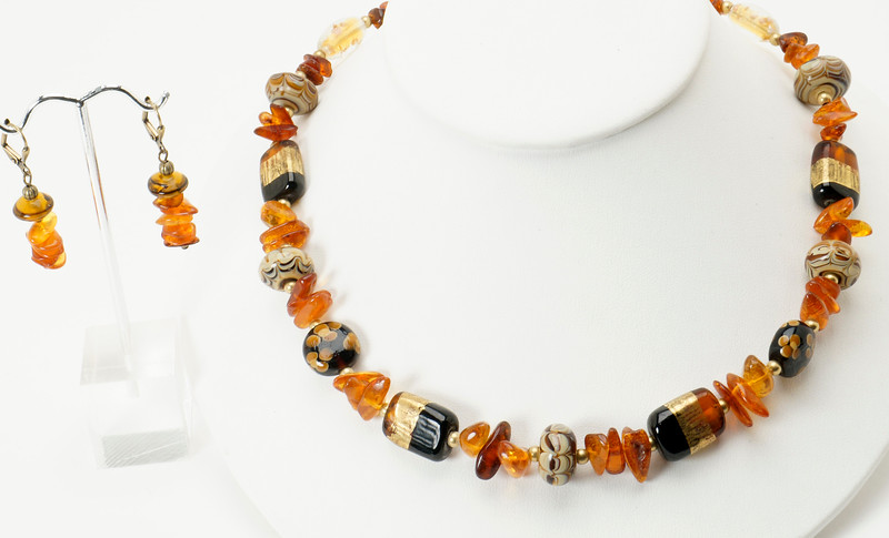 "#16019<br>Lamp glass and amber.<br>Antiqued bronze clasp and 4"" extender chain.<br>17.5"" to 21.5"" Limited Edition.<br>Necklace $115.00<br> Earrings not available."
