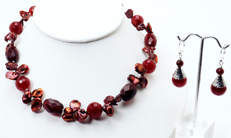 """#19818<br>Cranberry Keishi pearls and faceted color-treated jade.<br>Silver plated clasp and 4"""" extender chain.<br>17"""" to 21"""" Limited Edition.<br>Necklace 99.00<br>Earrings $28.00"""