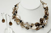 "#16617 <br>Shell, smokey quartz and pearls.<br>Silver plated clasp and 4"" extender chain. <br>Necklace 16"" to 20"" Limited Edition $195.00 <br>Earrings with silver ear wires $30.00"