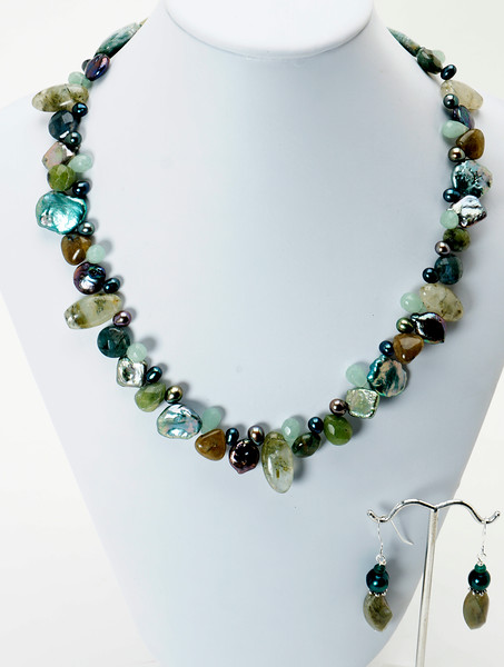 "#21219<br>Moss agate, Keishi pearls, jade, <br>Prehinite quartz, labradorite and green aventurine.<br>Silver plated Clasp and 4"" extender chain.<br>17"" to 21"" Limited Edition.<br>Necklace $175.00 Earrings $29.00"