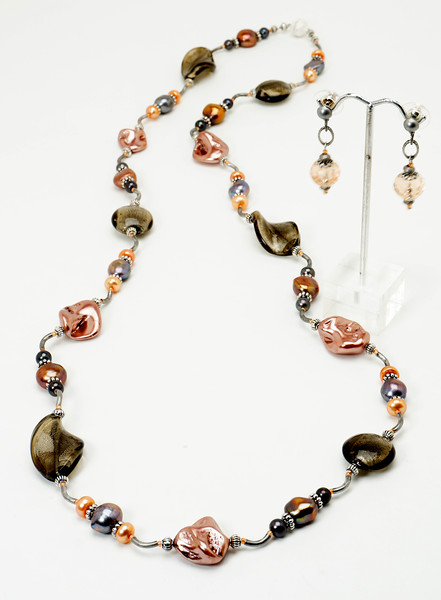 """#21518<br>Taupe lamp glass, pearls and shell pearls<br>With antiqued silver tubes.<br>Granulated silver magnetic clasp.<br>36"""" or doubled at 18"""".Limited Edition. <br>Necklace $175.00<br>Earrings $26.00"""