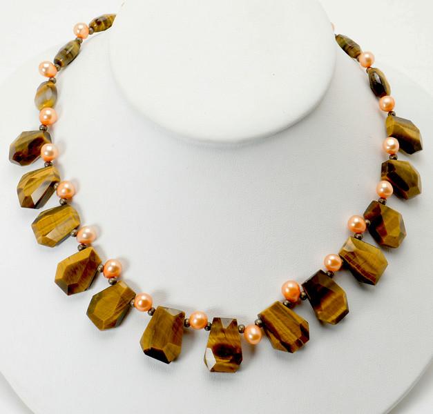 "#20719 <br>Tiger's eye and color-treated pearls.<br>Sliver plated clasp and 4"" extender chain.<br> 17.5"" to 21.5"" Limited Edition.<br>Necklace $99.00"