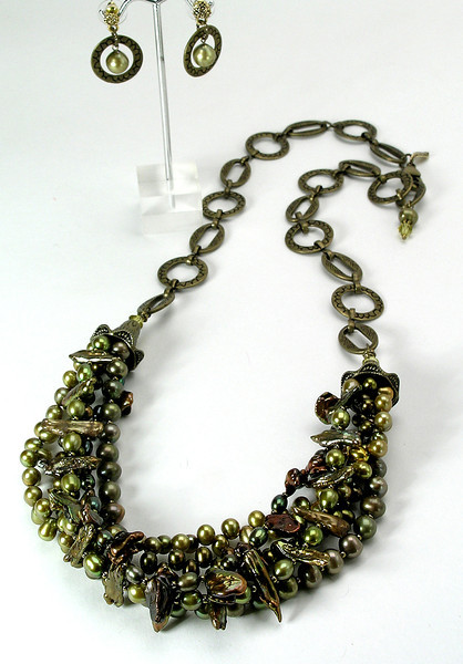 "#24813 <br> Five braided strands of olive and green pearls. <br>Antiqued bronze large lobster clasp, cones and chain.  <br>Alice Bailey Designs signature tag.<br> Necklace 30"" or less. Limited Edition $195.00<br> Earrings with antiqued bronze and surgical steel posts $34.00"