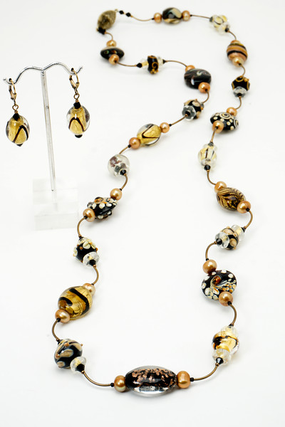 """#21318<br>Lamp glass, pearls and crystal<br>With antiqued bronze tubes<br>And magnetic clasp.<br>40"""" or doubled at 19"""" Limited Edition.<br>Necklace $195.00<br>Earrings $27.00"""
