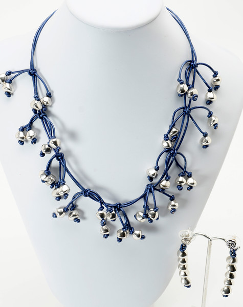 """#21119<br>Pewter on metallic blue Italian leather.<br>Silver plated clasp and 4"""" extender chain.<br>17"""" to 21"""" Limited Edition.<br>Necklace $175.00 Earrings $29.00"""