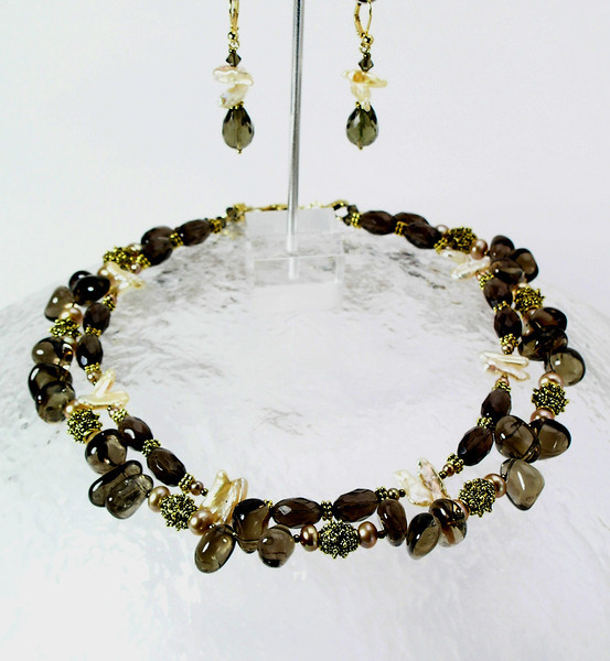 "#27912 <br>Smokey quartz, peach pearls and bronze. <br> Gold plated clasp and 4"" extender chain.<br>Alice Bailey Designs signature tag.  <br>Necklace  16.5"" to 20.5""  $150.00<br> Earrings with gold plated French clips $33.00"