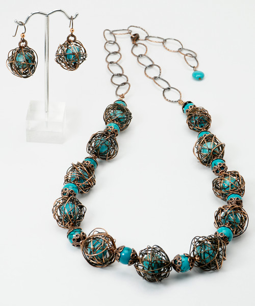 "#13217 <br>Antiqued, sealed copper wire wrapped magnesite turquoise<br> with turquoise and copper caps. <br>Antiqued copper clasp and large chain. <br>Necklace 30"" or less. Limited Edition $150.00 <br>Earrings with hypo-allergenic Niobium ear wires $39.00"