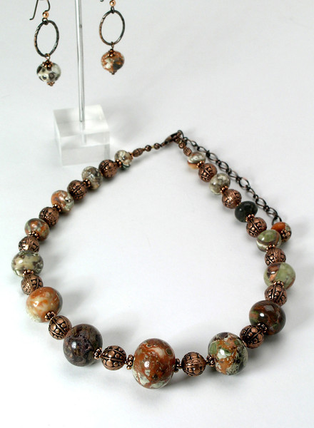 "#26613 <br>Graduated jasper and copper. <br>Antiqued copper clasp and 4"" extender chain.<br>Necklace 17"" to 21"" Limited Edition $95.00<br> Earrings with hypo-allergenic Niobium ear wires $45.00"