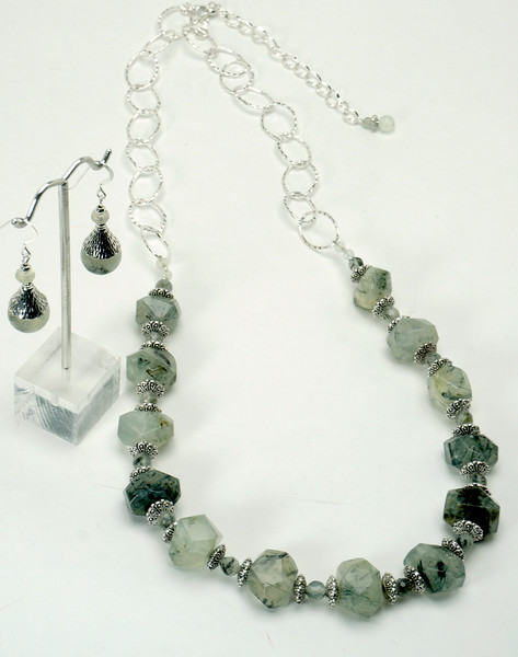 "#18617<br>Prehinite quartz, pewter and silver plated chain. <br>Necklace 27.5"" to 31.5"" Limited Edition $175.00<br>Earrings with silver ear wires $29.00"