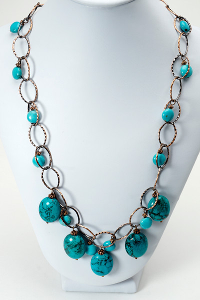 """#26716 <br>Turquoise and magnesite turquoise drops on antiqued copper chain, clasp and 4"""" extender chain.<br> 21"""" to 25"""" Limited Edition. $125.00"""