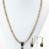 """#21619<br>Shell pearl and bronze drop<br>On sage pearls.<br>Antiqued bronze clasp and 4"""" extender chain.<br>20"""" to 24"""" Limited Edition.<br>Necklace $75.00<br>Earrings $29.00"""