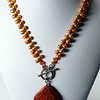 "#19719<br>Fire agate drop<br>On brick pearls.<br>Pewter toggle clasp.<br>18"" Limited Edition.<br>$115.00"