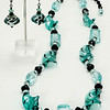 "#24618<br>Aqua and black lamp glass and crystal.<br>Nite black clasp<br>And 4"" extender chain..<br>26.5"" to 31"" Limited Edition.<br>Necklace $125.00<br>Earrings $30.00"