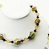 "#22119<br>Lamp glass, olivine and metallic violet crystal.<br> Nite black clasp and 4"" extender chain.<br>16"" to 20"" Limited Edition.<br>Necklace $50.00<br>Earrings $24.00"
