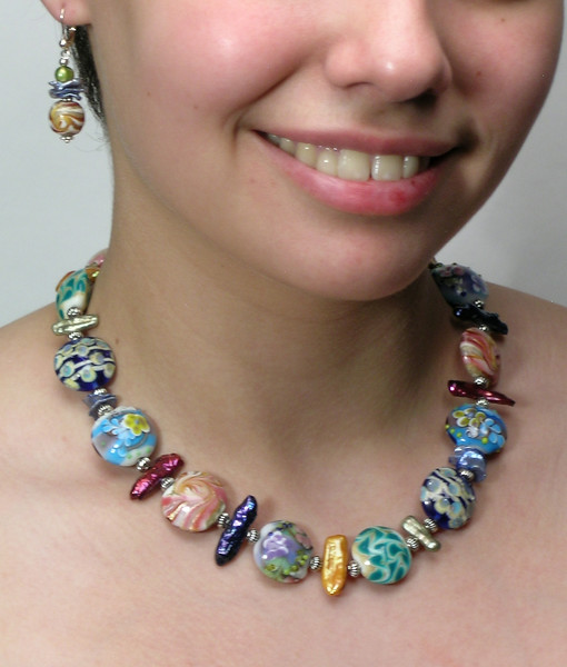 """#13412 <br>Multi-colored lamp glass, Biwa pearls and pewter.<br>Silver plated clasp and extender chain.<br> Alice Bailey Designs signature tag.<br>Necklace 16"""" to 20"""" Limited Edition $110.00<br>Earrings with silver plated French clips $32.00"""