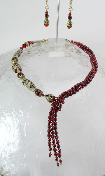 "#29012 Lamp glass, cranberry pearls, Swaovski crystal and bronze faux lariat. Gold plated clasp and 4 "" extender chain.<br>Alice Bailey Designs signature tag.<br> 17"" to 21"" Limited Edition.<br><br><a href=""https://www.paypal.com/cgi-bin/webscr?cmd=_cart&amp;add=1&amp;business=alice@AliceBaileyDesigns.com&amp;item_name=Alice%20Bailey%20Designs%20Item%20Number%29012%20Necklace&amp;item_number=29012&amp;amount=%24195.00&amp;return=http://www.paypal.com&amp;cancel_return=http://www.paypal.com"" target=""_click"" class=""paypalbutton"">Purchase Necklace $195.00</a><br><br> <br><br><a href=""https://www.paypal.com/cgi-bin/webscr?cmd=_cart&amp;add=1&amp;business=alice@AliceBaileyDesigns.com&amp;item_name=Alice%20Bailey%20Designs%20Item%20Number%2029012%20Earrings&amp;item_number=29012&amp;amount=%2429.00&amp;return=http://www.paypal.com&amp;cancel_return=http://www.paypal.com"" target=""_click"" class=""paypalbutton"">Purchase Earrings $29.00</a><br><br> <br><br><a href=""https://www.paypal.com/cgi-bin/webscr?cmd=_cart&amp;add=1&amp;business=alice@AliceBaileyDesigns.com&amp;item_name=Alice%20Bailey%20Designs%20Item%20Number%2029012%20Earrings%20and%20Necklace&amp;item_number=29012&amp;amount=%24224.00&amp;return=http://www.paypal.com&amp;cancel_return=http://www.paypal.com"" target=""_click"" class=""paypalbutton"">Purchase Necklace and  Earrings $224.00</a><br><br> <br><br><br><br><img src=""http://ali.smugmug.com/Other/WebSiteImages/i-BftLFq2/0/O/paypal-175-50-O.jpg""><br><font class=""captionfooter"">Free Shipment on all Orders</font>"