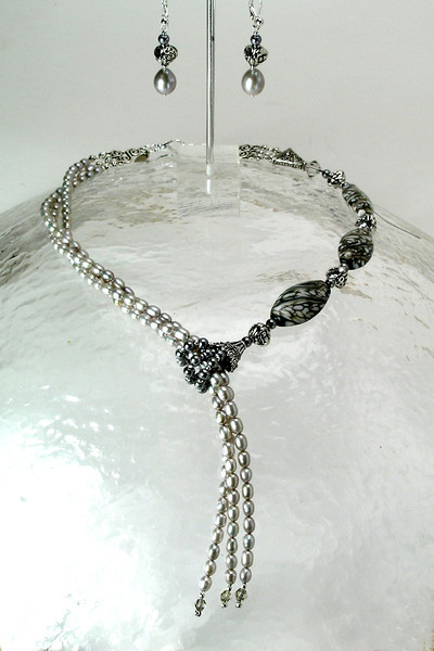 "#10314 <br>Taupe and white lamp glass, <br>Silver pearl and pewter faux lariat. <br>Silver plated clasp and 4"" extender chain. <br> Alice Bailey Designs Signature Tag. <br>Necklace  17"" to 21"" Limited Edition $195.00<br>Earrings with silver plated French clips $28.00"