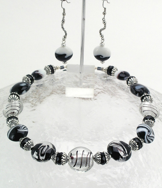 "#19612 <br>Black, white & silver lamp glass, crystal and pewter. <br> Silver plated clasp and 4"" extender chain.<br>Alice Bailey Designs signature tag.<br>Necklace 16.5 "" to 20"" Limited Edition $95.00<br>Earrings not available."