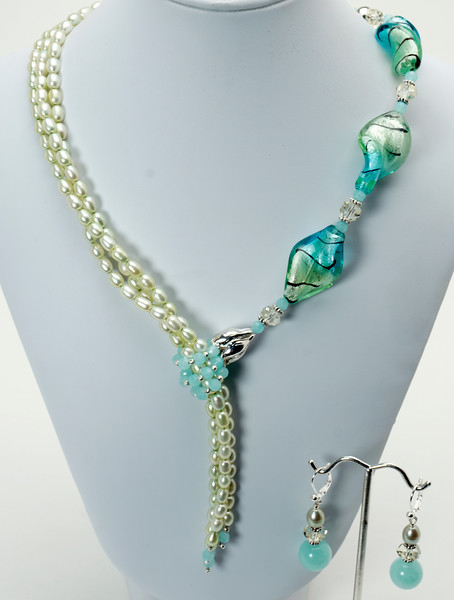 "#11318<br>Lamp glass, honeydew pearls <br>topaz and crystal faux lariat. <br>Silver plated clasp and 4"" extender chain. <br>Alice Bailey Designs signature tag.<br>17"" to 21"" Limited Edition.<br>Necklace $195.00 <br>Earrings with silver plated French clips $30.00"