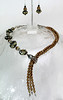"#16913 <br>Black and caramel lamp glass,gold  pearls, crystal and pewter Asymmetric faux lariat. <br>Silver plated clasp and 4"" extender chain. <br>Alice Bailey Designs signature tag.<br>16.5"" to 20"" Limited Edition $195.00<br>Earrings with sterling silver ear wires $38.00"