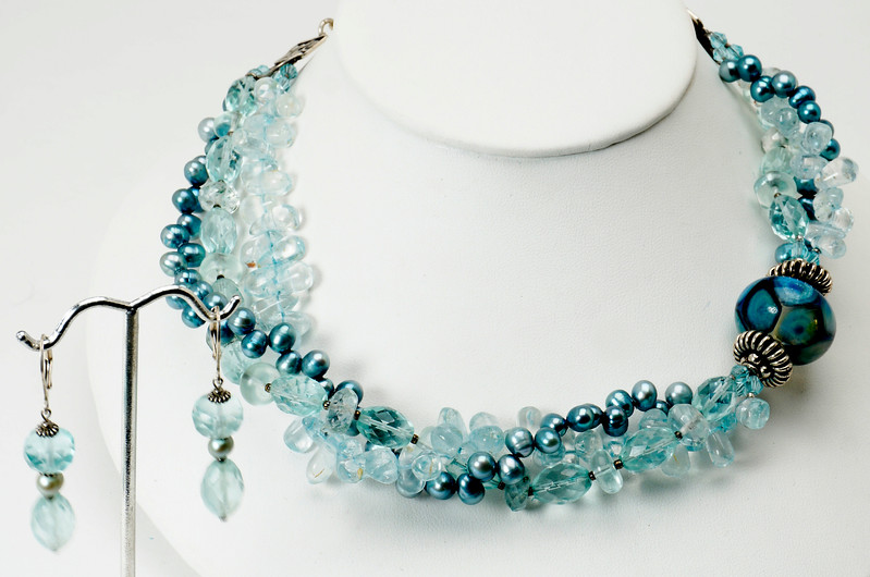 "#14007 <br>ymmetrical one-of-a-kind art glass, sterling silver, <br>pearls and aqua crystal. <br>Sterling silver hook clasp and 4"" extender chain. <br> Necklace 16"" to 20"" One-of-a-kind $350.00<br>Sterling silver French clip earrings $35.00"