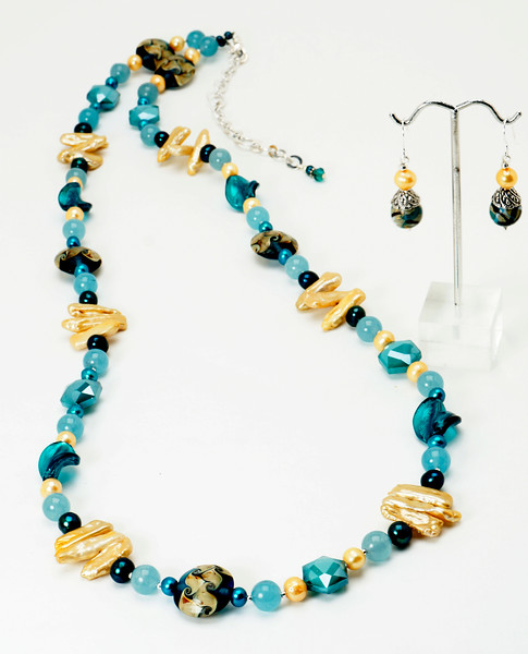 """#14619<br>Lamp glass, pearls, angelite and crystal<br>Silver plated clasp and 5"""" extender chain.<br> Necklace $165.00<br>Earrings $30.00"""